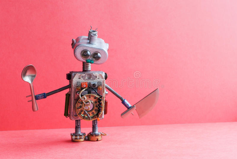 Mechanical kitchen chef robot knife spoon. Funny toy cooking character for restaurant food menu advertising poster royalty free stock photo