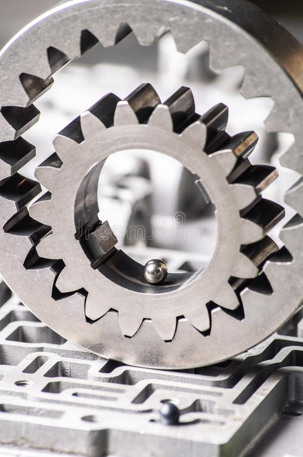 Mechanical metal pattern with large steel gears for the background. stock images
