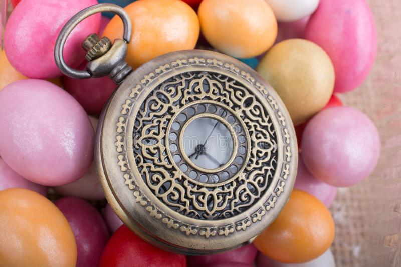 Mechanical pocket watch on colorful candy stock image