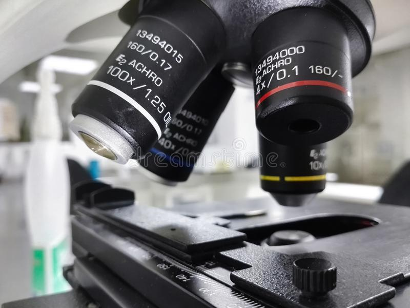 Mechanical stage and objective lenses of a microscope equipment royalty free stock image