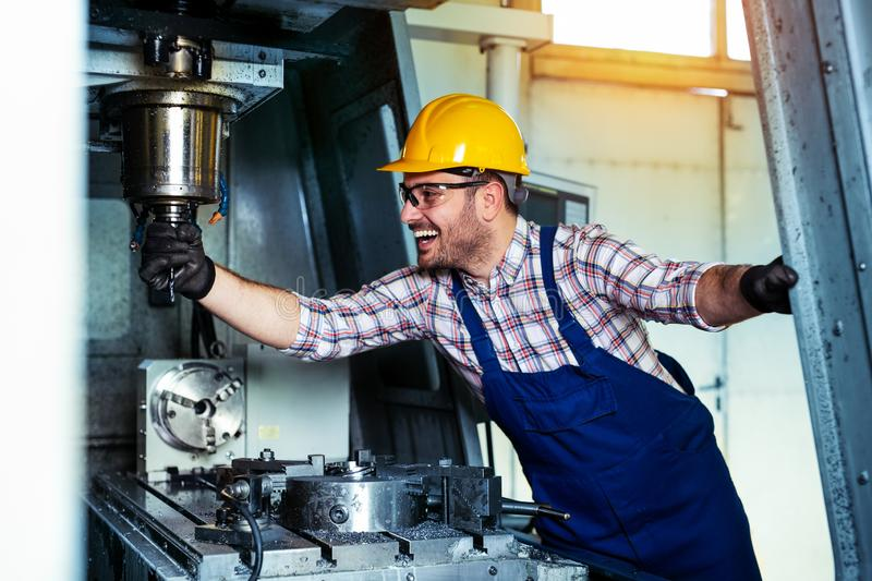 Mechanical technician worker of cnc milling cutting machine center at tool workshop manufacturing royalty free stock photography