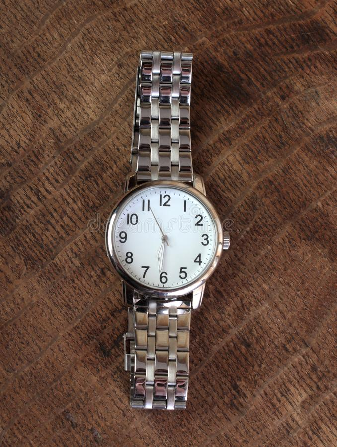 Mechanical watch one. Manual mechanical watch on an old wooden table royalty free stock photos