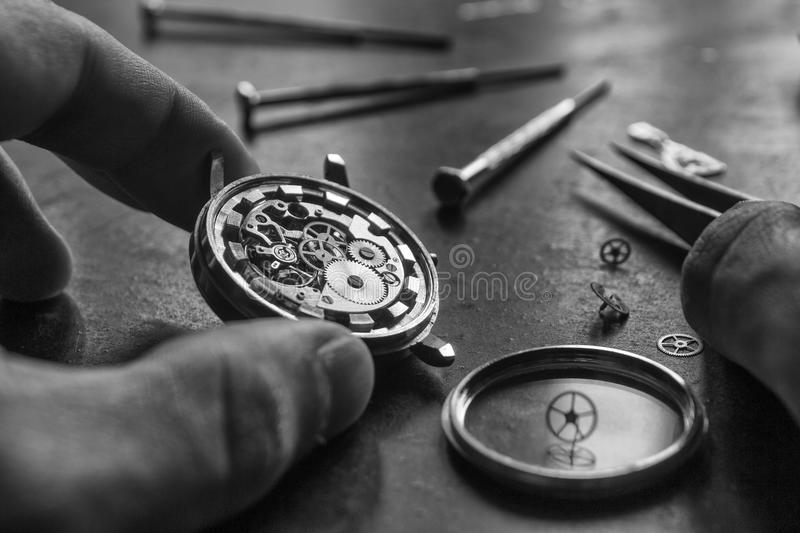 Mechanical watch repair royalty free stock images