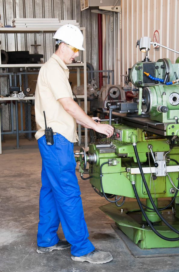Mechanical work at industrial factory royalty free stock photography
