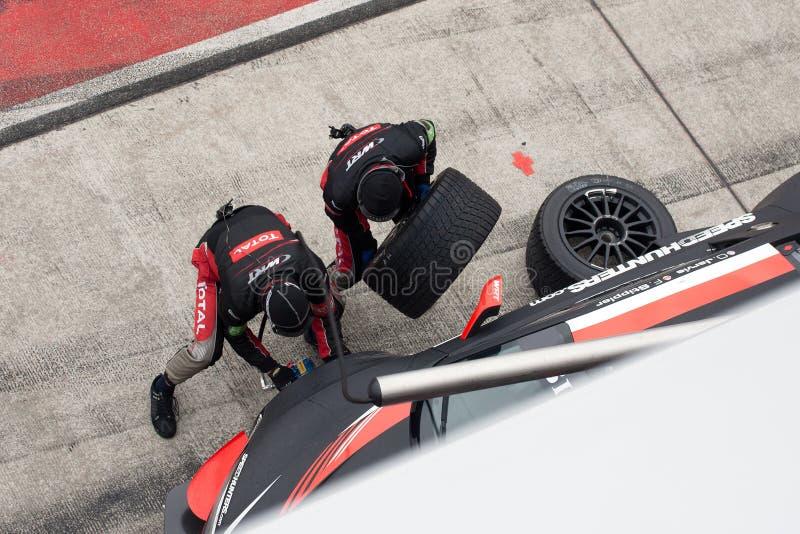 Mechanics changing tyre royalty free stock photos