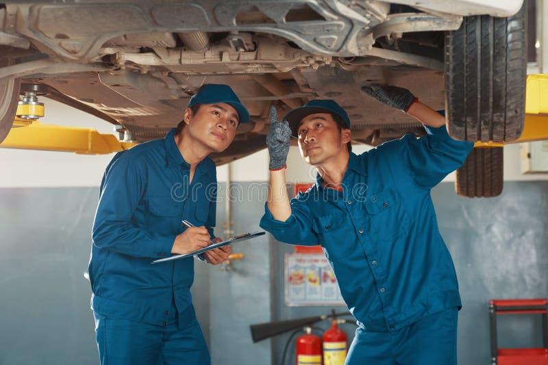 Mechanics inspecting problems stock image