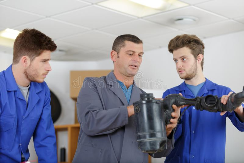 Mechanics training class with teacher and students stock photos