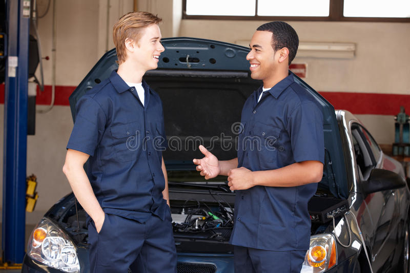 Mechanics at work. Talking and smiling royalty free stock images