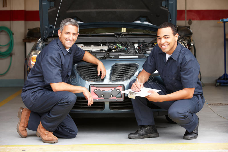 Mechanics at work. In front of car royalty free stock photography