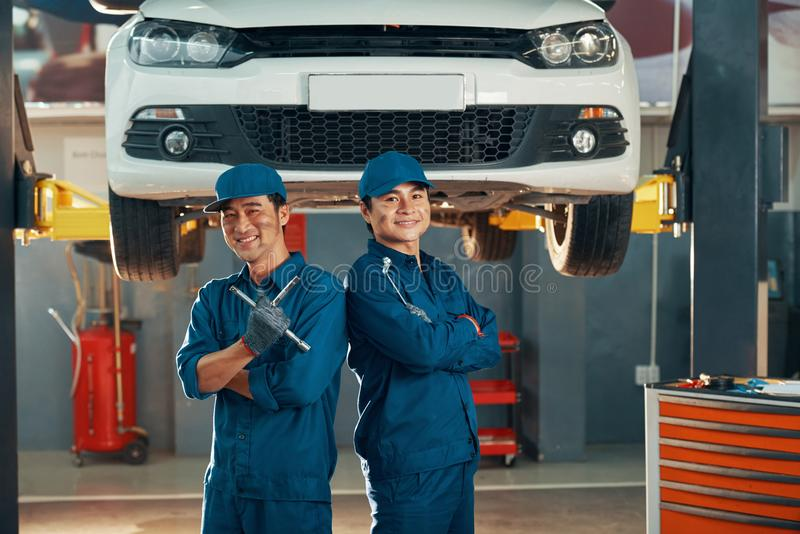 Mechanics working in auto service stock photography