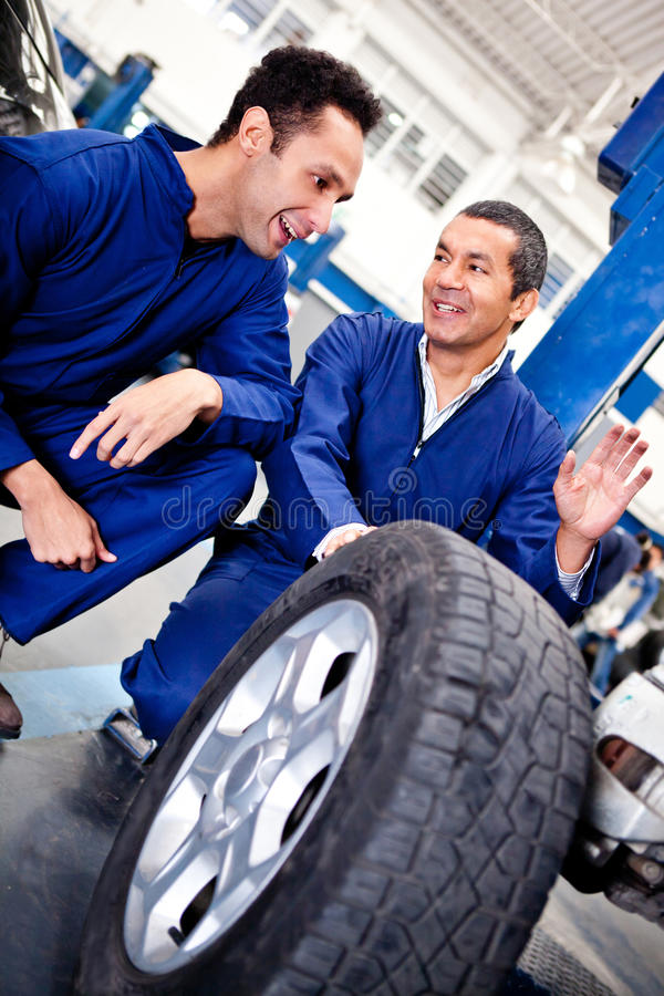 Download Mechanics Working On Car Puncture Stock Image - Image: 23845935