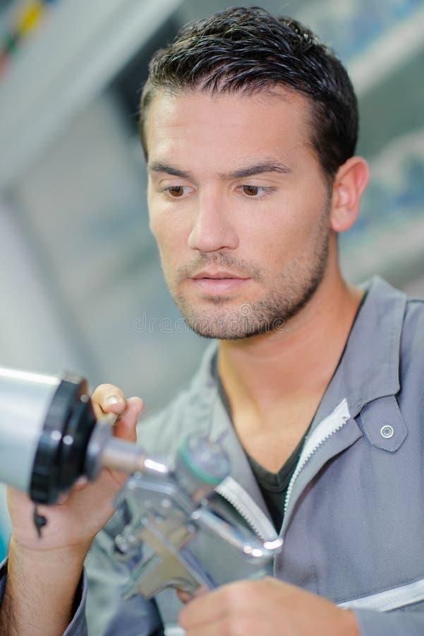 Mechanika mienia składników kiści pistolet obraz stock