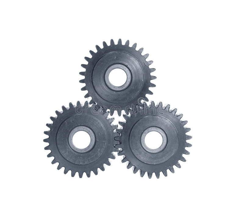 Mechanism with cog-wheels. Mechanism with three cog-wheels on white background royalty free stock image