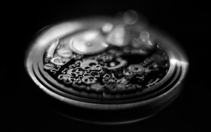 Skeleton hours. Antique antique clockwork, jewelry engraving. mechanical pocket watch close-up, selective focus. Mechanism with gears. clockwork skeleton royalty free stock photos