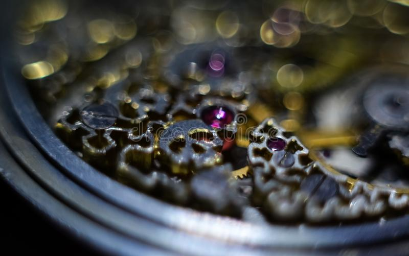 Skeleton hours. Antique antique clockwork, jewelry engraving. mechanical pocket watch close-up, selective focus. Mechanism with gears. clockwork skeleton stock photography