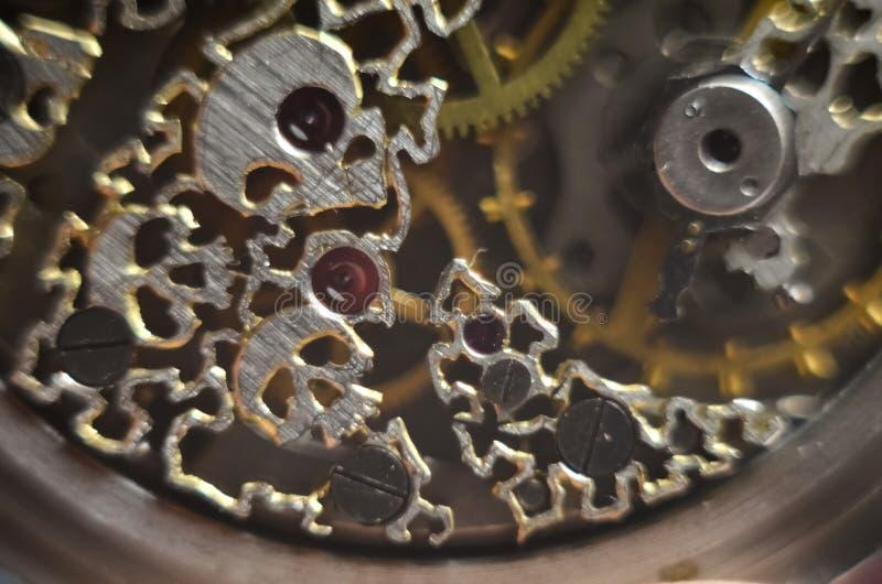 Skeleton hours. Antique antique clockwork, jewelry engraving. mechanical pocket watch close-up, selective focus. Mechanism with gears. clockwork skeleton stock images