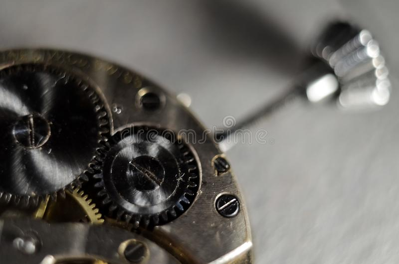 The mechanism of old antique pocket watches, Close up view of old clock`s gears. selective focus stock photography