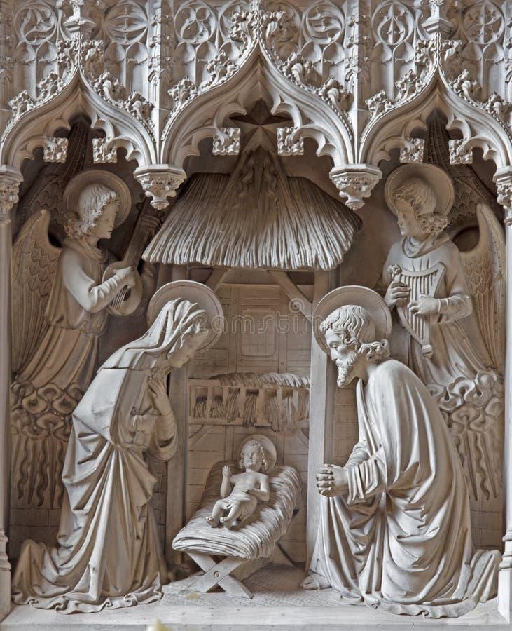 Mechelen - den neogotic skulpturala gorupen av kyrkan eller Katharinakerk för Kristi födelsest Katharine arkivfoto