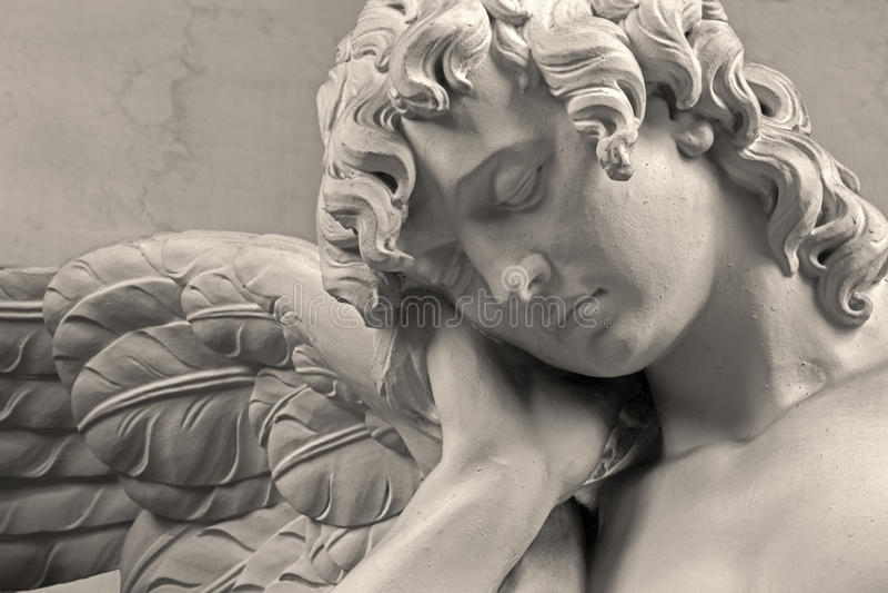Mechelen - The sorrow of angel. Detail of stone statue in church Our Lady across de Dyle. MECHELEN, BELGIUM - JUNE 14, 2014: The sorrow of angel. Detail of stock photography