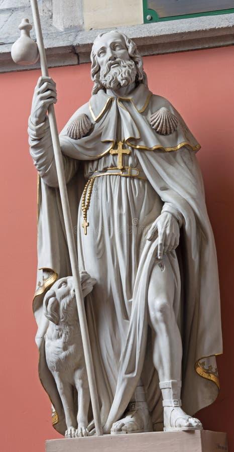 Mechelen - The statue of st. Roch st. Katharine church or Katharinakerk. MECHELEN, BELGIUM - JUNE 14, 2014: The statue of st. Roch st. Katharine church or stock image