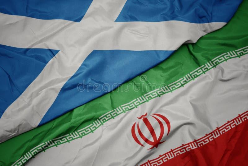 med färglös flagg från iransk och nationell flagg från skotland, royaltyfri bild