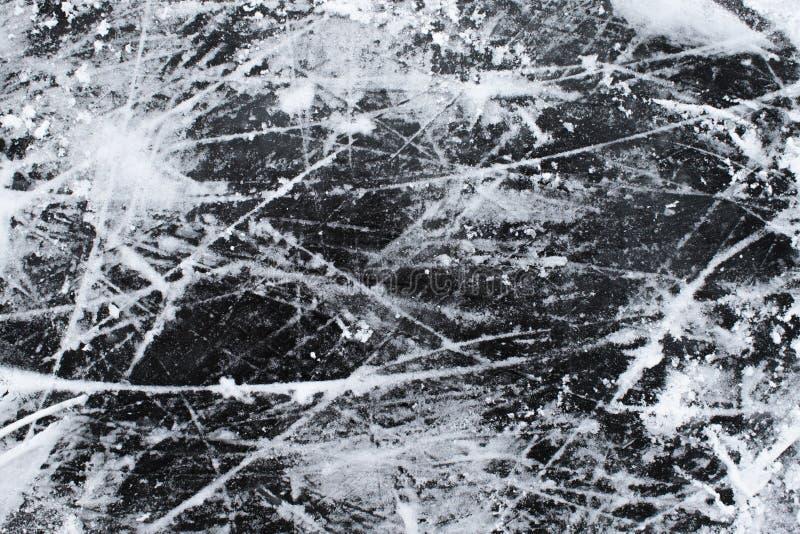 Is med snö- och skrapatexturbakgrund arkivfoto