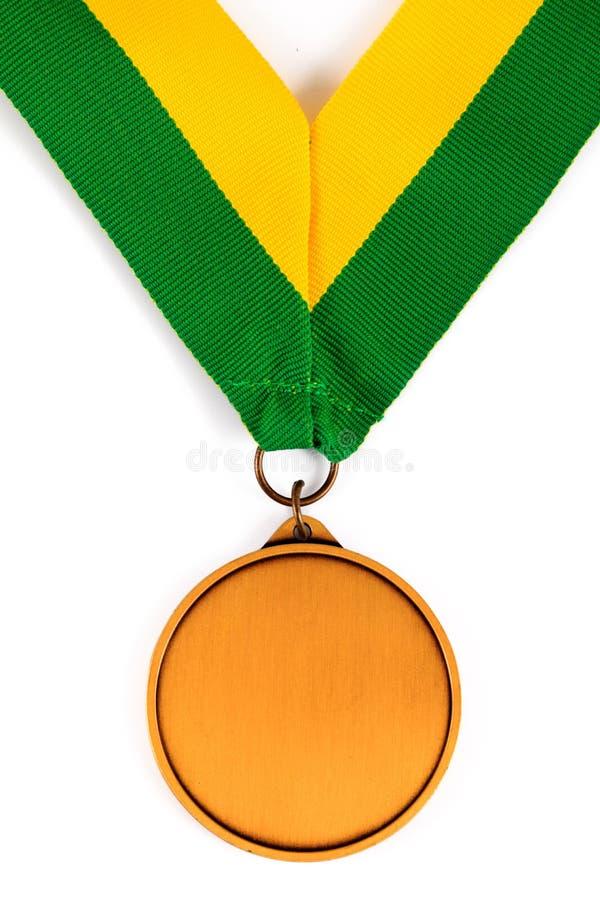 Medaglia d'oro su fondo bianco con il fronte in bianco per testo, medaglia d'oro nella priorità alta fotografie stock libere da diritti