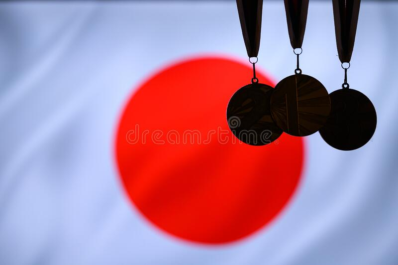 Medal silhouette, japan flag in background. White space, asia game royalty free stock photography