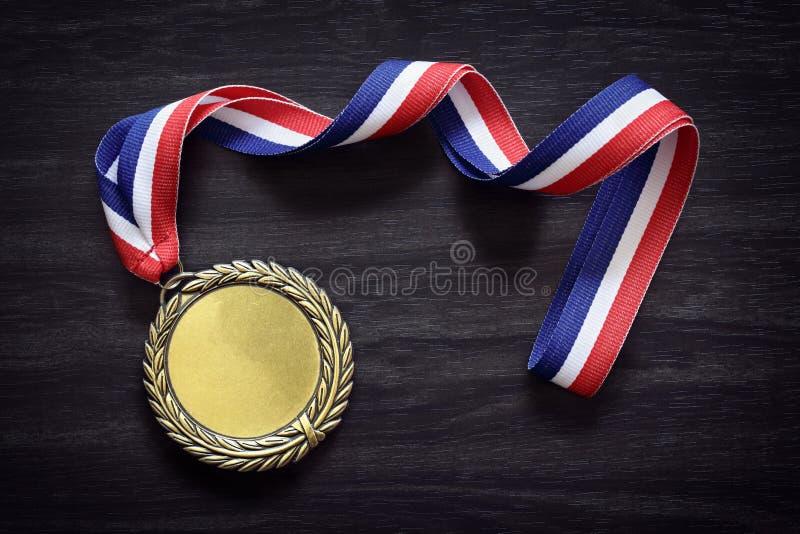 Medalha de ouro olímpico fotografia de stock royalty free