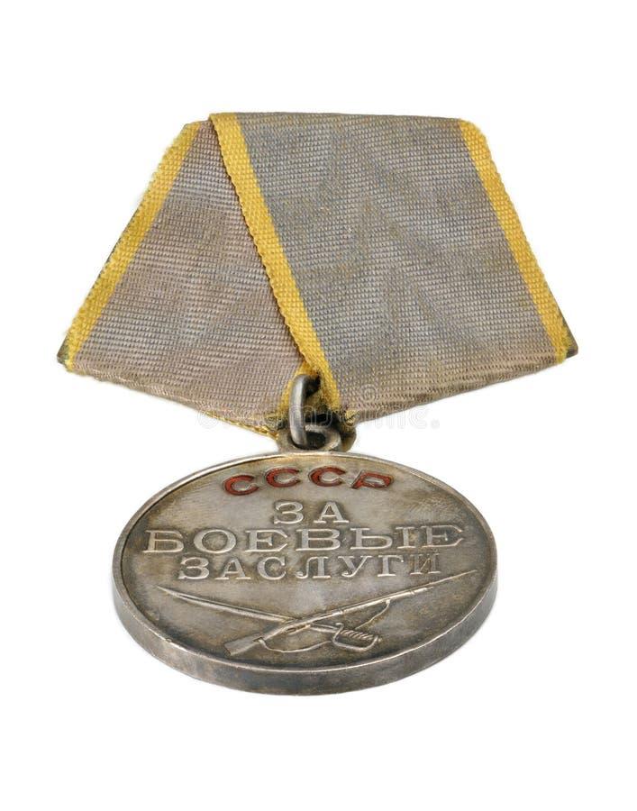 Medalha soviética para o mérito da batalha no fundo branco fotografia de stock