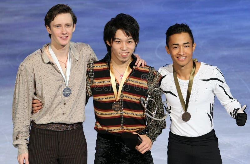 Medaliści w mężczyzna przerzedżą łyżwiarstwo obrazy stock