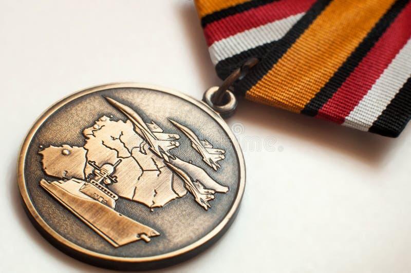 Medalj av den ryska avdelningen av försvar tilldelad till medlemmar av den militära operationen i Syrien royaltyfri fotografi