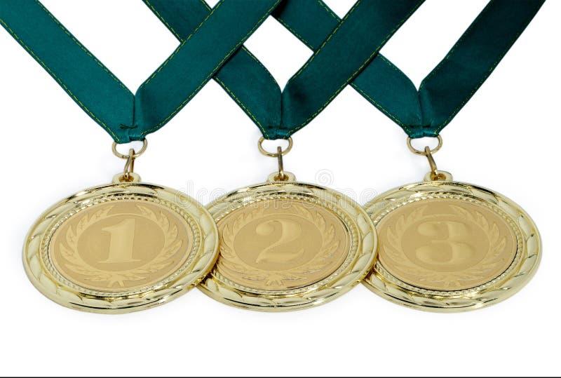 Medaljer med band för vinnare av konkurrenser som isoleras på en wh royaltyfri bild
