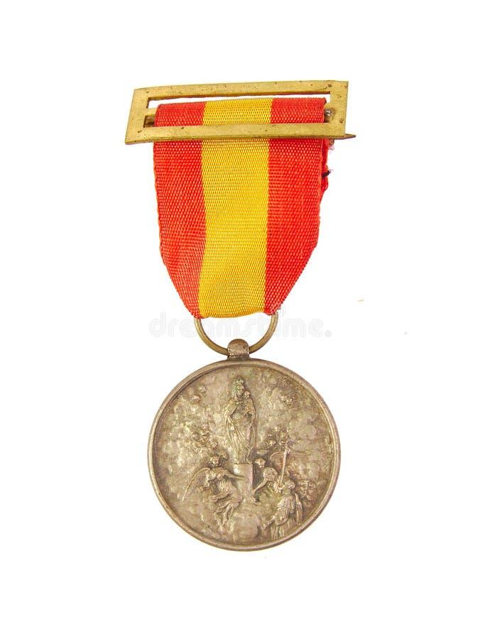 Medalla de honor que muestra la bandera española y a nuestra señora foto de archivo