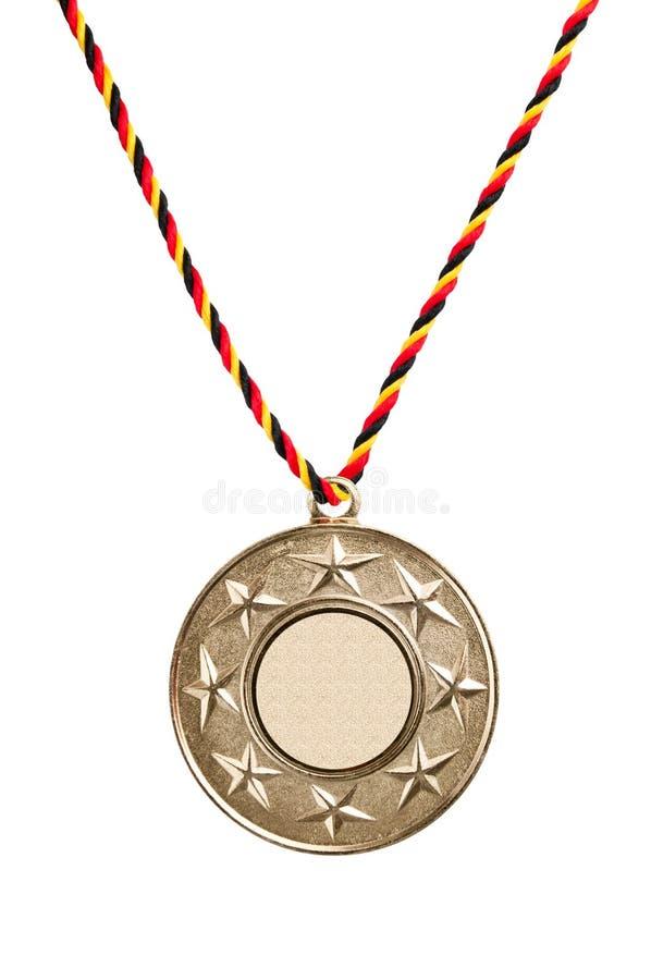 Medalla de oro en blanco fotos de archivo