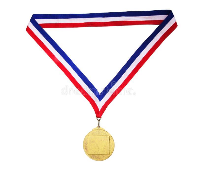 Medalla de oro en blanco fotografía de archivo