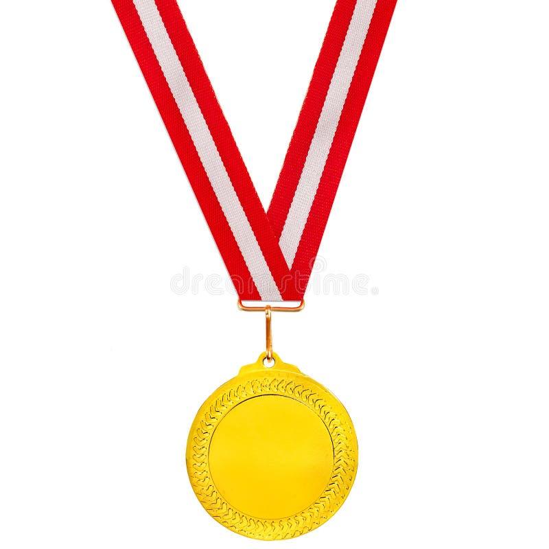 Medalla de oro en una cinta roja y blanca fotografía de archivo libre de regalías