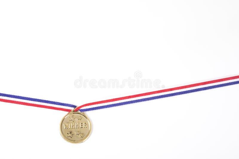 Medalla de oro para un ganador de la competencia en blanco imagen de archivo libre de regalías