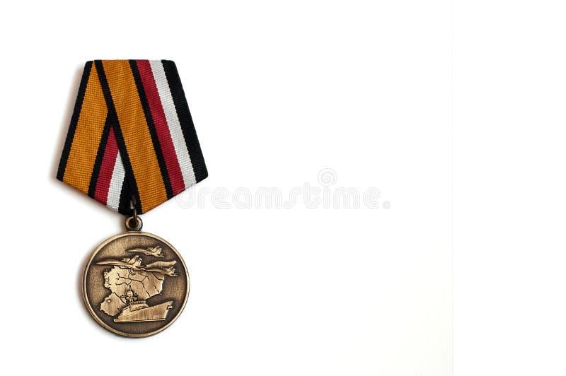 Medalla del departamento de defensa ruso dedicado a los miembros de la operación militar en Siria foto de archivo
