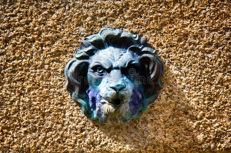 Medallions of lions fountain in the city. Limoges, France - September 28, 2017: Medallions of lions fountain in the city. Relief medallion Leo royalty free stock images