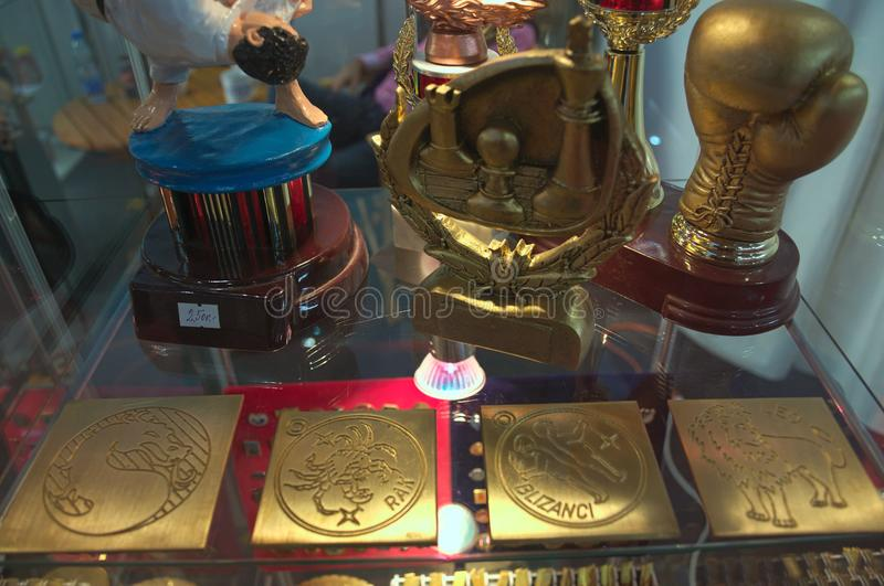 Medals and awards on display during jewelry expo.  royalty free stock photo