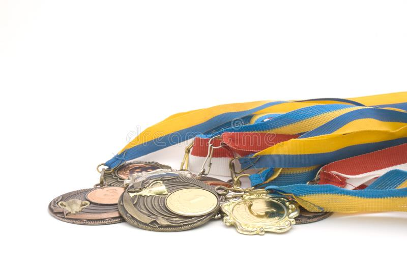 Medals close up. Contest games medals close up sport awards ceremony  white background royalty free stock images
