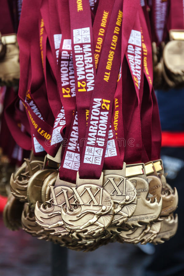Medals of the Rome Marathon. Rome, Italy - March 22, 2015: 21th medals of the Rome Marathon will be distributed to the athletes after the finish line royalty free stock photography