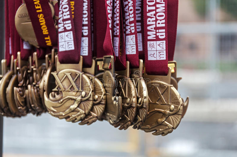 Medals of the Rome Marathon. Rome, Italy - March 22, 2015: 21th medals of the Rome Marathon will be distributed to the athletes after the finish line stock image