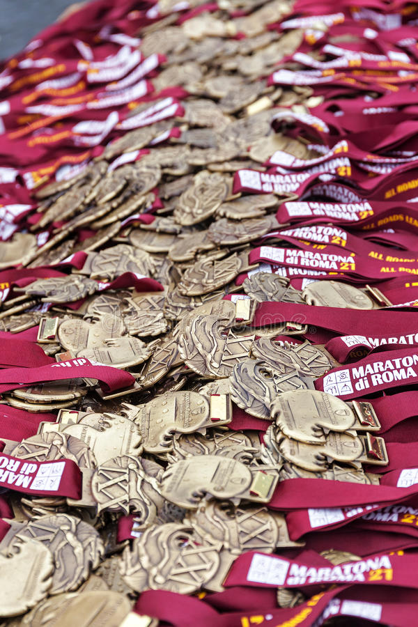Medals of the Rome Marathon. Rome, Italy - March 22, 2015: 21th medals of the Rome Marathon will be distributed to the athletes after the finish line royalty free stock photo