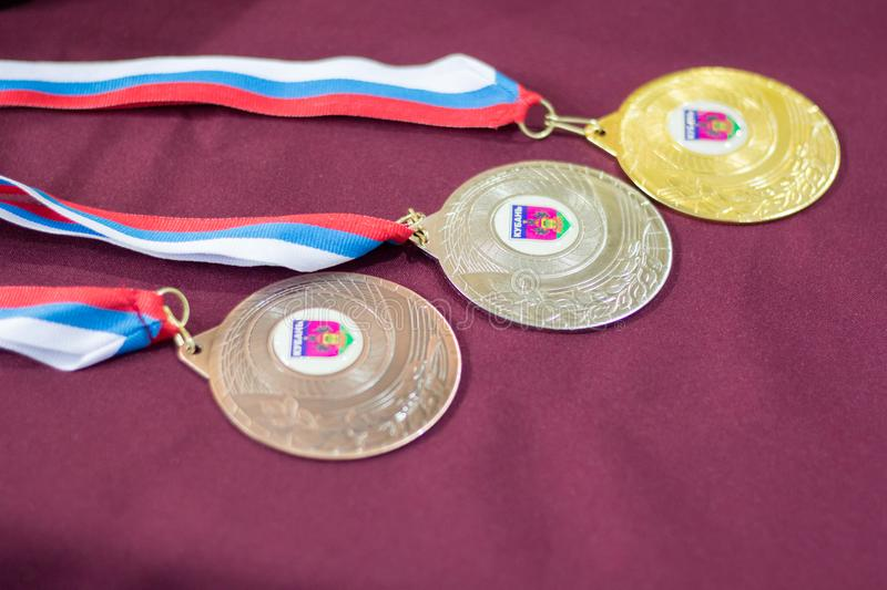 Medals for the winners of the tennis tournament. Medals for the winners of the children`s tennis tournament stock images