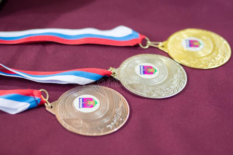 Medals for the winners of the tennis tournament. Medals for the winners of the children`s tennis tournament stock photos