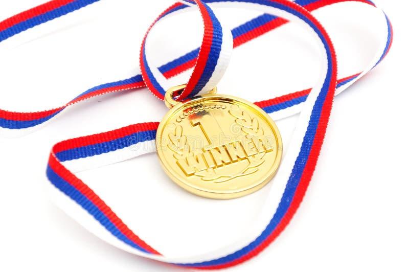medalu złoty odosobniony biel zdjęcia royalty free