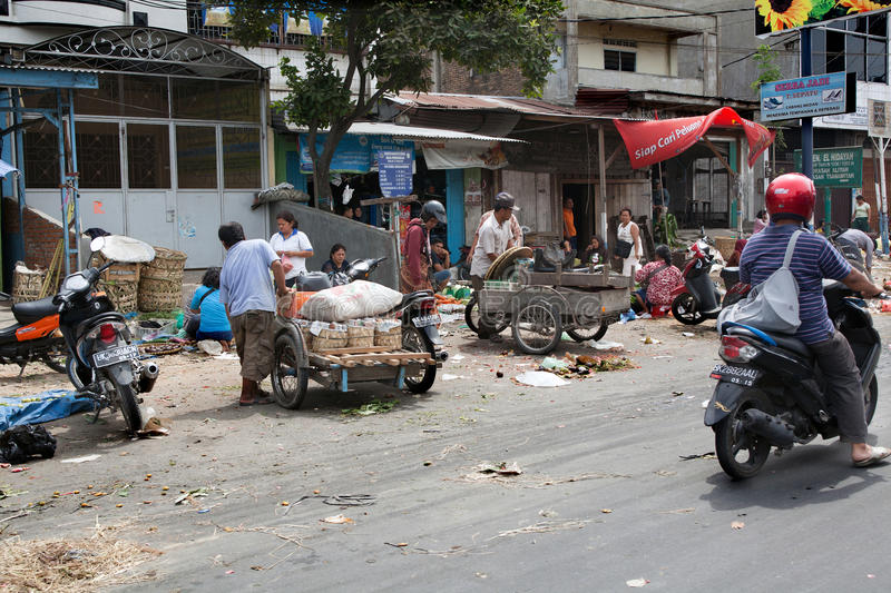 MEDAN, INDONESIA - AUGUST 18,2012: People transported goods in m. Otorcycle wagon royalty free stock photos