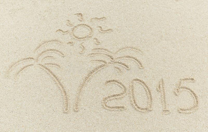 Meddelande 2015 för nytt år på sandstranden royaltyfria bilder